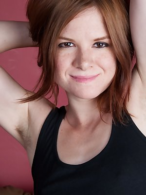 In her black tank top, Zia slowly takes off her clothes, and shows off her sexy body. Her petite breasts, hairy pits, and slender figure are one thing, but her red hairy pussy is a natural marvel.
