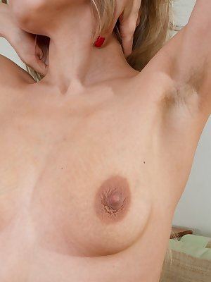 Hairy woman Loredana is a sexy blonde beauty wearing a stunning red dress with bright red panties on as she slowly strips out of her clothes and then poses naked showing off her warm hairy pussy.