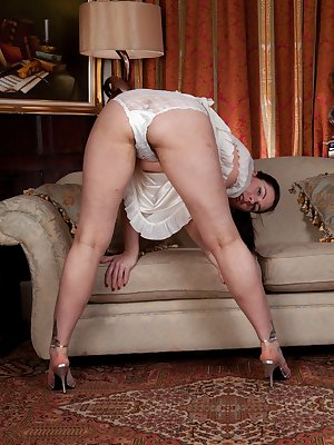 Hairy woman Sharlyn knows that she shouldn't be turned on every time she wears white. She is though. She enjoys slowly stripping and showing her beautiful dark haired pussy to her lover.