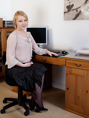 Danniella is a beautiful hairy model with a nice full body and an even better bush. At work she clears everything off the desk and hops onto it, giving the best views of what she has down there.