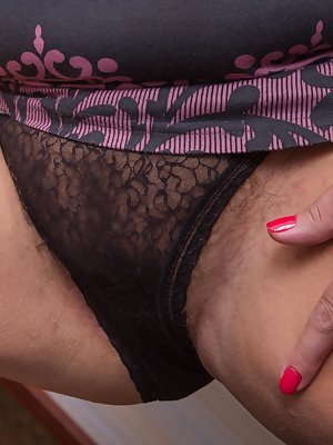 Looks like we've caught Lariona in the middle of a little cleaning. That's okay, because she seems to like the idea of showing us her beautiful curves and sexy hairy pussy better.