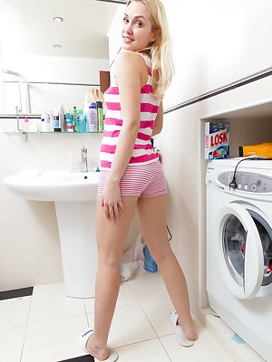 Hairy girl Felicia is a sexy blonde beauty who is doing her laundry but she wants to wash everything so she strips out of her clothes until she is naked and then bored she shows off her hairy pussy.