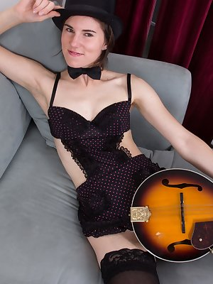 When hairy Kiyoko decides to entertain, she shows her sensual side. She happily plays her mandolin when she is dressed in lingerie. As she plays, she strips and shows off her hairy pussy and body.