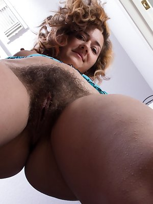 When it's time to go shopping, hairy woman Isabel loves to go. She enjoys trying on different clothes. She also loves to try on lingerie. As she strips, she loves to play with her pretty hairy pussy.