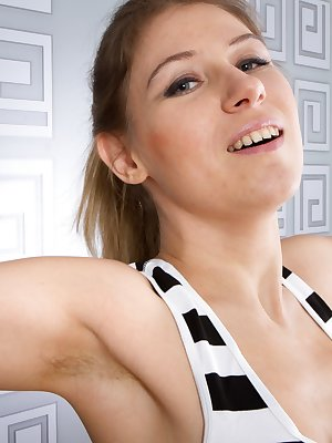 Loredana is a sexy blonde beauty wearing black and white stripped stockings with a matching outfit as she strips naked and then shows off her warm hairy pussy in a close up view of her pussy.