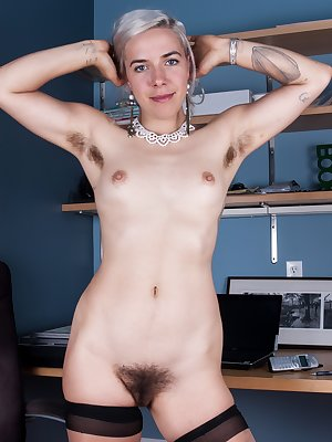Cordelia has had a rough day at the office and she unwinds by stripping out of her suit and her stocking. She shows off her hairy girl body and then takes off her panties showing off her hairy pussy.