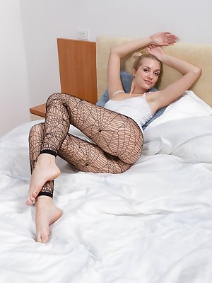 Hairy woman Felicia is a sexy blonde who is laying in bed while wearing her sexy black fishnet leggings as she slowly strips naked teasing the camera with a slight hint of her hairy pussy at first.