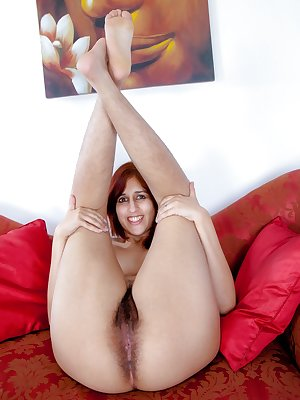 Jasmine Z sits on her couch contemplating what to do. She begins to take off her clothes showing off her cute pink underwear and hairy legs. Pulling off her panties she spreads her hairy pussy lips.