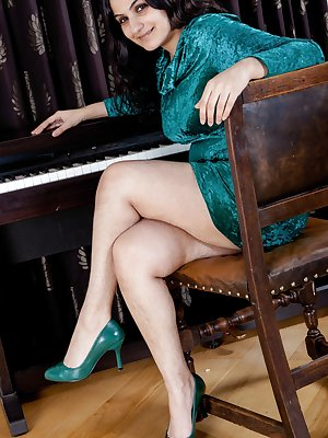 Riani is a hairy woman that is always in demand for her erotic piano lessons. This bbw is one that doesn't mind stripping out of her dress, lingerie and showing how pretty her natural hairy pussy is.