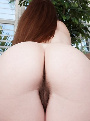 Annabelle Lee is enjoying a sunny day in the park when she gets an itch she has to scratch. She heads home and runs her hands down her body to her hairy pussy in this tantalizing hirsute gallery.