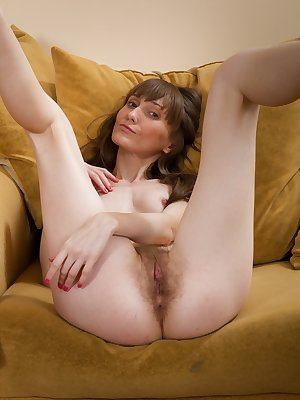 Gela comes home from a holiday event and she can't help but love how she feels. Her red tights rub against her hairy pussy and drives her crazy. She strips and touches her pretty pink snatch.
