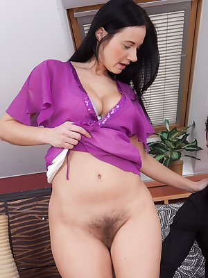 Enza sits texting on the couch, when her hot friend appears. She pulls out his hard cock, and puts it in her mouth. He enters her hairy pussy pounding her hard until he cums all over her hot bush.