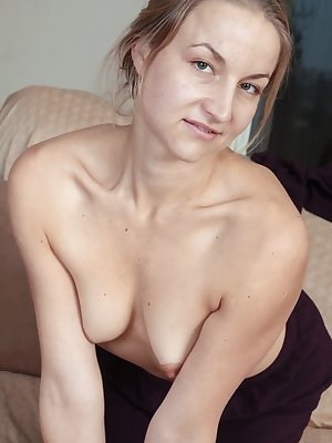 Hairy Rachel is ready to call it a night, but not before she plays with her hairy little pussy. She begins to take off her clothes showing off her cute hairy mound and spreading her pussy lips.