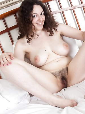 While getting ready for bed, hairy girl Tamar strips off her lingerie, exposing her full, wet bush. She plays with  her heavy full breasts and opens her legs, spreading her hairy pussy's lips.