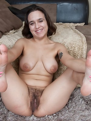 Viola Starr leans back on a leather corner couch, as her gorgeous bush pops out. She strips down giving you the perfect view of her beautiful hairy pussy. Pulling her legs up she lets you see more.