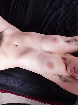 Ivy wakes up and stretches which shows off her hairy armpits. Her hairy bush peeks out of her lingerie bottoms. So she slips off everything to stroke her hairy, luscious bits.