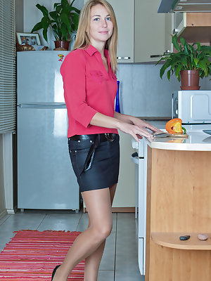 Melisa is in the kitchen cutting up a hot pepper. And then she gets hot herself and strips out of her clothes and her denim skirt and uses the piece of the hot pepper to tease her hairy pussy for you.