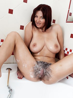 Hairy girl Vanessa J walked into the bathroom in her white lingerie After sitting on the counter and admiring her hairy pussy she decides to use the shower wand to wash up and feel very clean.