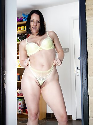 Hairy girl Amber lustful is in the kitchen pantry as she looks out the doorway. She decides to get naked and slowly strips out of her bra and panties teasing the camera with her hairy pussy.
