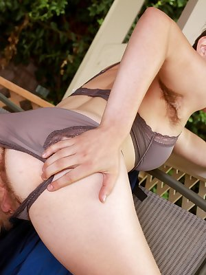 Sitting out on her back porch sexy Agnes decides it's too hot and she opens up the front of her dress and sticks her hand down her sheer panties to touch her hairy pussy, before getting naked.