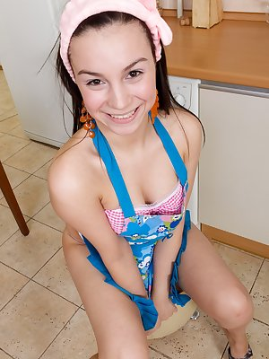 What could be a better snack then a gorgeous hairy girl wearing nothing but an apron and some really sexy picnic panties? How about watching hairy girl Dana get down right there in the kitchen!