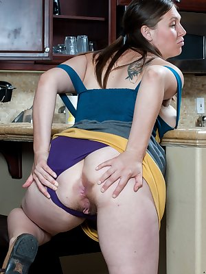 Lindsay is minding her own business in the kitchen when suddenly she can't help but want to finger herself. She takes off her dress and goes to town on her hairy mound right there in the kitchen!