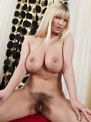 Underneath her beige dress blonde bombshell Vanessa J has some pretty bright panties on; but under that lays her extremely hairy mound, which you won't want to miss in this hairy porn!