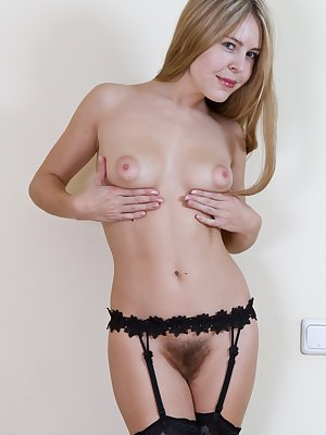 Chloe B is having a boring day at home and decides to spice things up  by showing off her sexy body in some stockings. Once her clothes are off you can see she is a hairy girl!