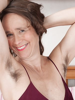 Josie is in her red dress in her bedroom, and loves to show off her hairy pits and pussy. She gets all naked, and spreads her legs to let us see her hairy bush. She smiles and has a totally natural body.