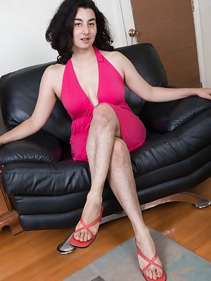 Wara just got a new pink dress and she's showing it on her black chair. She has hairy legs and loves to showing them. The dress and panties slide off and she shows off her hairy pits and body in bliss.