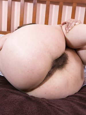 In her bed, Guadalupe has sexy thoughts and is laying around having them. She strips all her clothes off in bed, and is feeling naughty. She touches her hairy pussy all over and shows off her bush.
