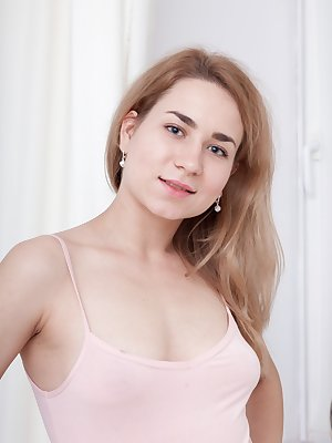 Nara Abel is in her blue skirt and pink top, showing off her figure. She strips nude and loves to masturbate. She gets her purple vibrator and starts fucking her hairy bush and orgasming for all.