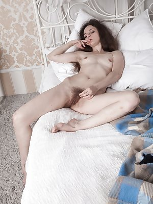 Lisa Li wakes up with a cold and tests her temperature all over her body. She strips naked to cool down, and shows the camera her hairy pits and bush. She then masturbates and fingers herself to glee.