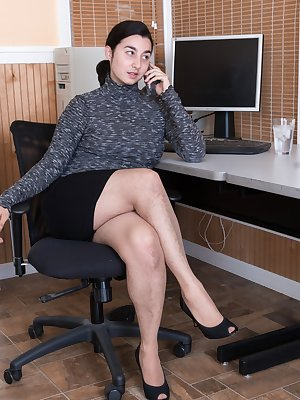Wara is sitting at her desk in her grey sweater and black skirt. The day is done, so she strips naked and displays her hairy pussy. She climbs on her desk naked showing off her naturally hairy body.