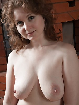 Bazhena is relaxing by her fireplace and stripping off her dress, lingerie, and stockings. She touches her hairy pussy and hairy pits, and enjoys laying naked across her floor all naked and horny.