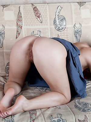 Indy has some red pantyhose on and she sits on the couch and slowly removes them. As she has her feet above her head and is pulling her pantyhose off she spreads her hairy pussy open. She then uses her fingers to spread her lips apart for a crystal clear