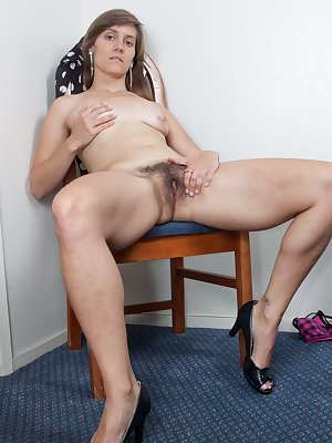 Suzette looks pretty in her dress and open toed heels. She strips out of her clothes and sits on the chair to suck on her toes and when she's done, she plays with her hairy pussy and her ass!