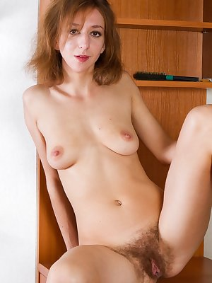 Darina gets hot and wild in her kitchen and gives a little peep show on her stove.  As things heat up, she decides to strip down and finger her hairy pussy.