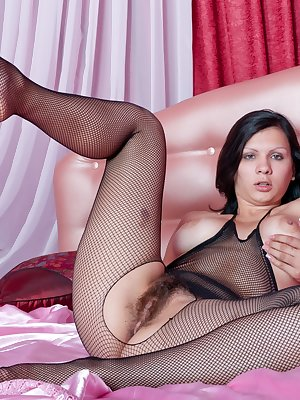 Bianka is a babe that knows how to move her body. She just loves wearing her favorite see through outfit that exposes her nice hairy pussy. Bianka spreads her legs apart so you can witness her pussy at its best.