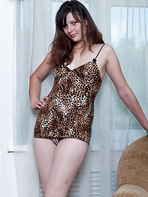 Gerda is a young brunette girl with natural breasts and a hairy pussy.  She sits in her chair massaging her breasts and fingering her pussy and ass for you to watch.