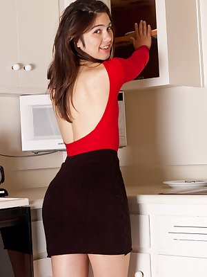 Wearing her skin tight top and black skirt, Felix is in the kitchen. She knows that she doesn't want to get anything on her outfit, so she takes off everything and plays with her naked hairy pussy!