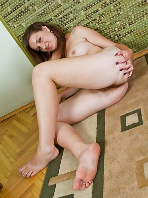 As cute as Nadya looks in her red dress and panties she takes them off. Her pussy looks better without anything covering her hairy mound! When she spreads her legs you can see she is one hairy girl!