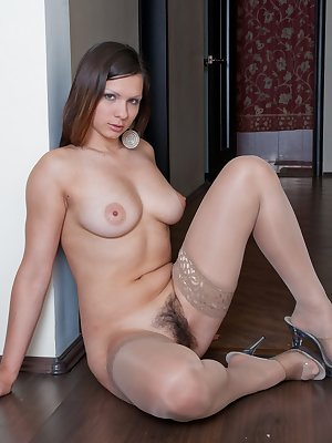 Bianka sue knows how to give a good stiptease session. Let her show you how to work a hot body like hers. She strips all the way down to her nice hairy pussy. A little finger play never looke so good.