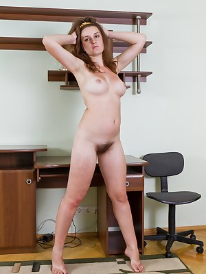 Nadya is wearing black suspenders. But they are only for show because they make look hot! Like when she lifts her skirt up and you can see all that hair on her pussy and ass! She is one hairy girl!