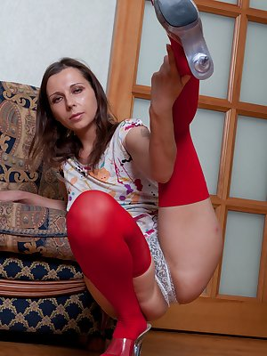 Magda is wearing a very short dress. It barely covers her red thigh high stockings! She may as well take it and her panties off. Which leaves just her stockings on as she plays with her hairy pussy!