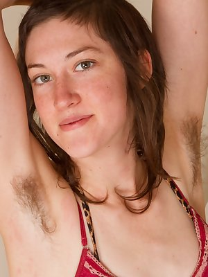 May wants her fans to know how hairy she really is as she undresses herself. She tugs and pulls on her pussy hair and slips her fingers into her creamy hole.