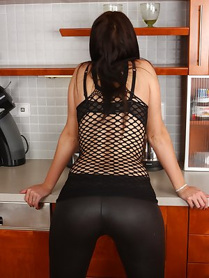 Sexy minx Walleria is in the kitchen and wants to take off her tight leather pants and black mesh top. Will you let her undress her gorgeous natural body?