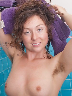 Luca finds herself being a bit dirty so she needs to take a bath. She puts on a sexy striptease as she gets in the tub. Once shes in, she shows off her hairy pussy. Her large breast bounce up and down