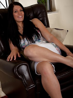 Kinky Kandie Luv sits down on her chair and slowly takes off her sexy white panties. Her dark pussy hair is thick and loves to be twisted in her fingers