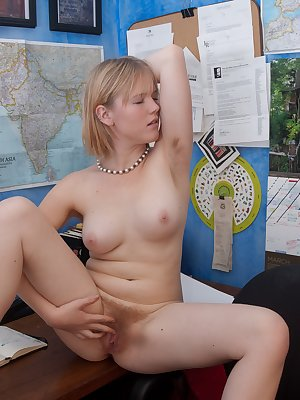 Eve Kisa has had a hard day and can't wait to get frisky. She pulls down her skirt and plays with her tender hairy pussy.